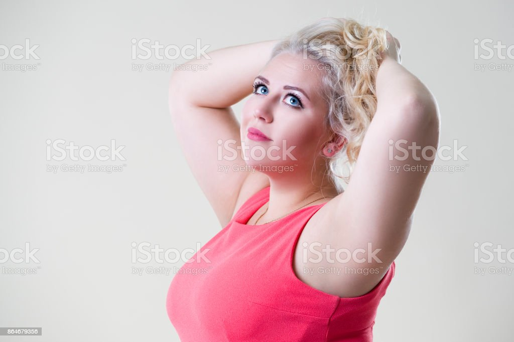 Plus size fashion model woman on beige background, overweight female body stock photo