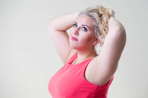 plus size fashion model woman on beige background, overweight female body - beautiful curvy girls stock photos and pictures