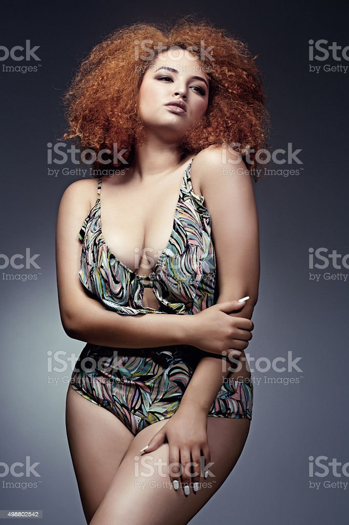 plus size lingerie model posing stock photo