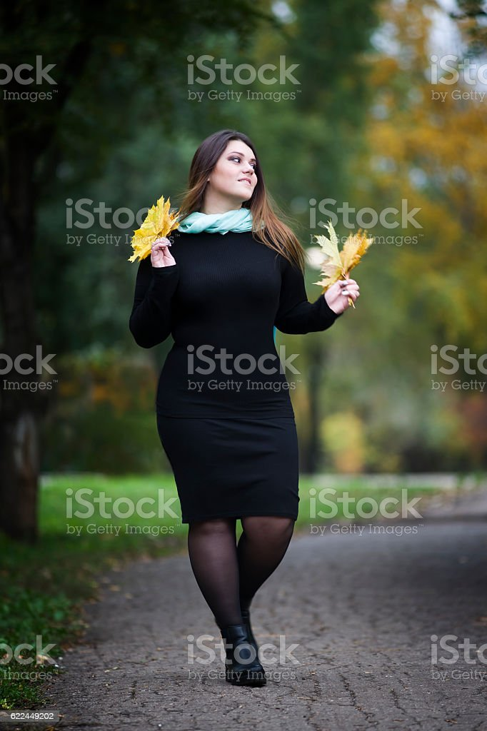 Plus size model outdoors, xxl woman on nature, autumn atmosphere stock photo