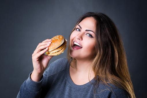 Plus Size Model Posing With Hamburger Xxl Woman Eating