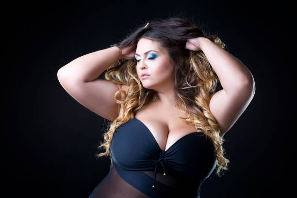 Plus size model with big breast in black bra stock photo