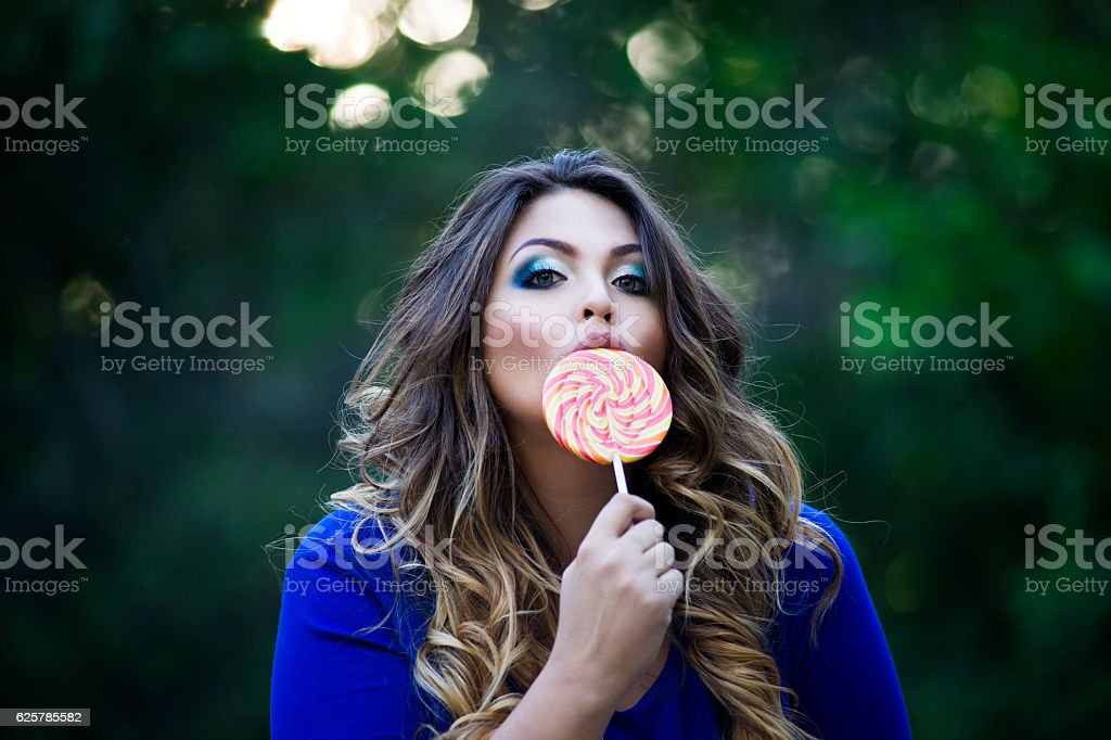 Plus Size Model Xxl Woman On Nature Licking A Lollipop Stock