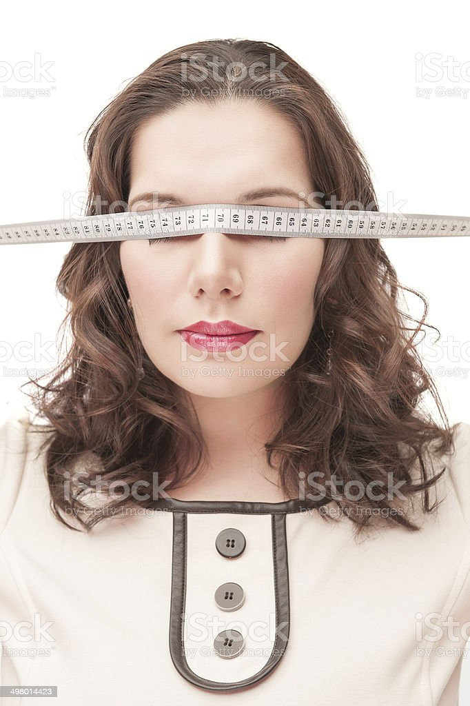 Plus size woman blindfold with centimeter royalty-free stock photo