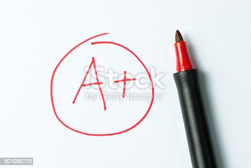 istock A plus written with red pen 921055210