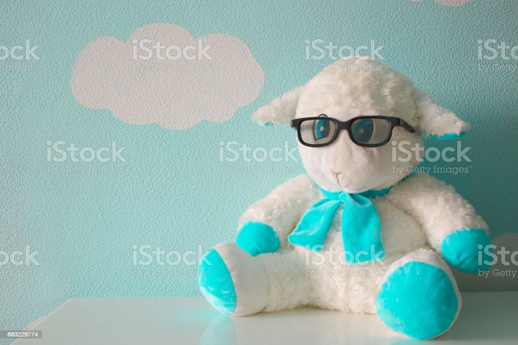 Plush sheep with glasses royalty-free stock photo