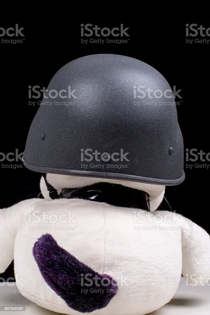 plush toy dog wearing helmet stock photo