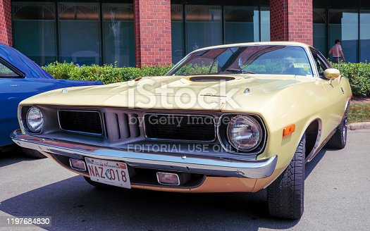 Moncton, New Brunswick, Canada - July 10, 2015  : 1974 Plymouth Cuda parked in downtown Moncton during 2015 Atlantic Nationals Automotive Extravaganza.