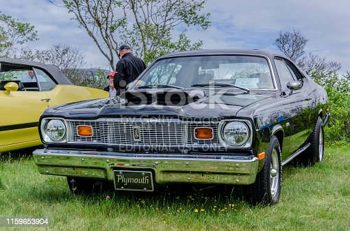 Chester, Nova Scotia, Canada - June 22, 2019 : 1976 Plymouth Duster on display at annual Graves Island Car Show at Graves Island Provincial Park, Chester, Nova Scotia Canada.