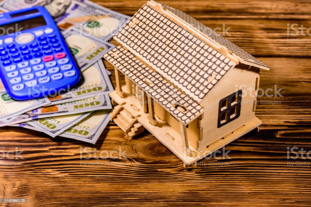 Plywood Model Of The House Calculator And One Hundred Dollar