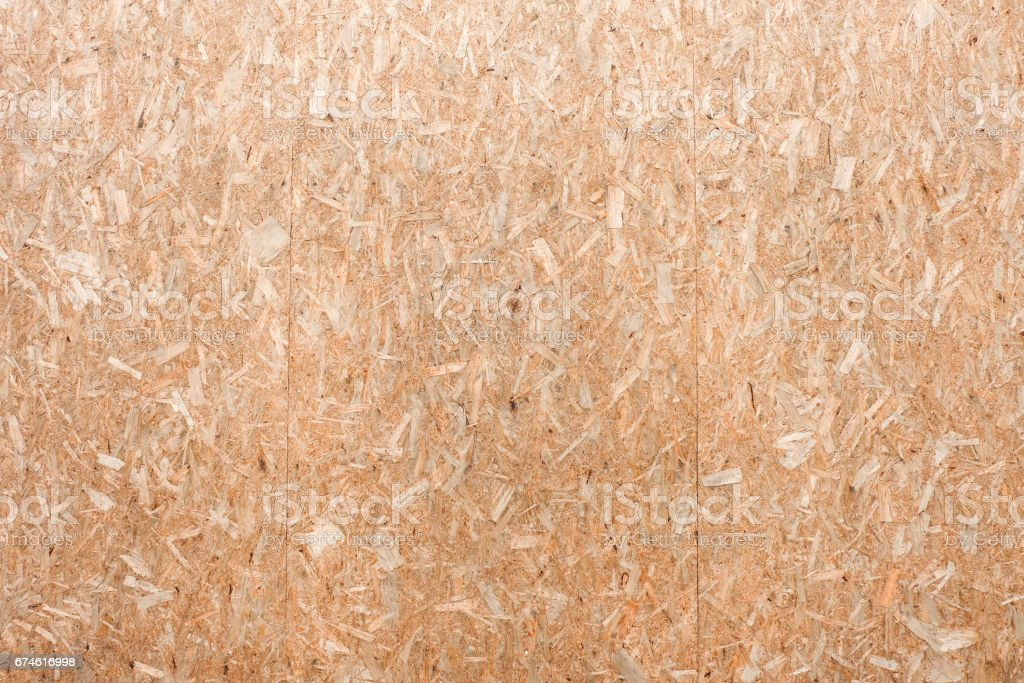 OSB plywood or oriented strand board, wood wall background texture stock photo