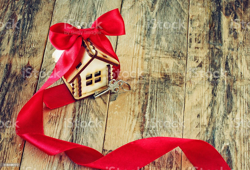 plywood small house with red ribbon and key stock photo