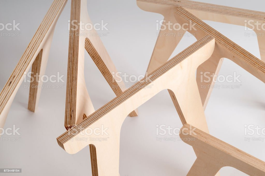 Plywood Table Legs on Gray Background stock photo