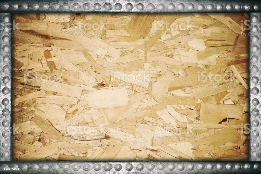 Plywood texture with metal rivets frame stock photo