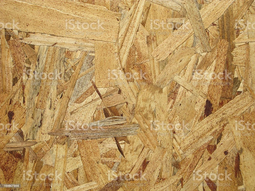 OSB Plywood Wood Waferboard Chipboard Construction .  Oriented strand board, also known as OSB, waferboard, Sterling board or Exterior board (UK) and SmartPly (UK & Ireland), is an engineered wood product formed by layering strands (flakes) of wood in specific orientations. In appearance, it may have a rough and variegated surface with the individual strips  lying unevenly across each other. Abstract Stock Photo