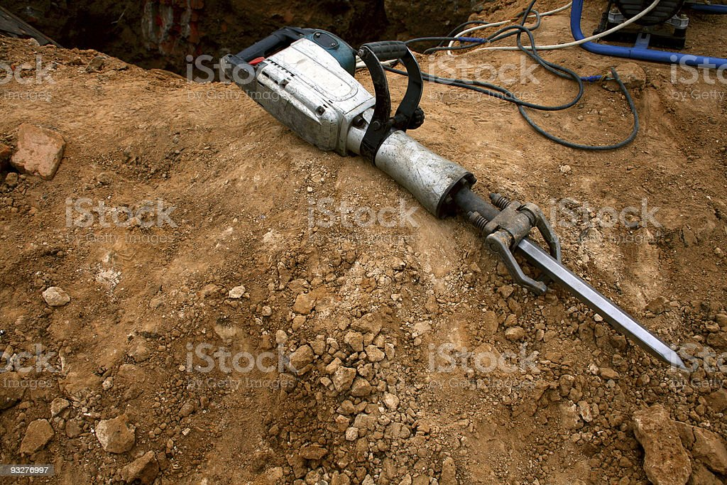 Pneumatic hammer lying on the ground stock photo