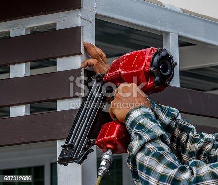istock Pneumatic nails gun shooting 687312686