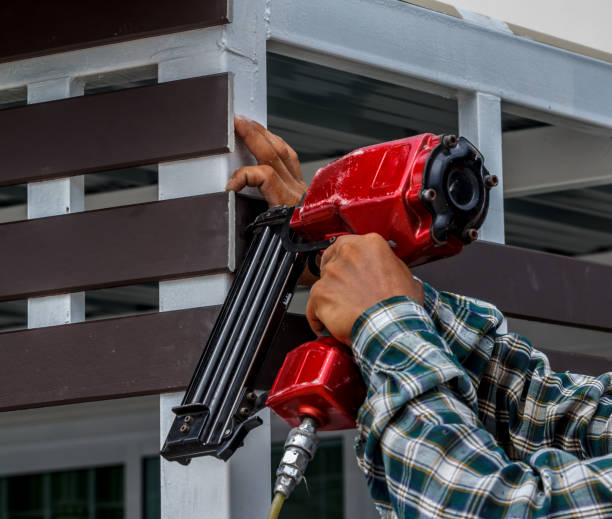 Pneumatic nails gun shooting Gun construction shoot the nails in the wooden wall nail work tool stock pictures, royalty-free photos & images