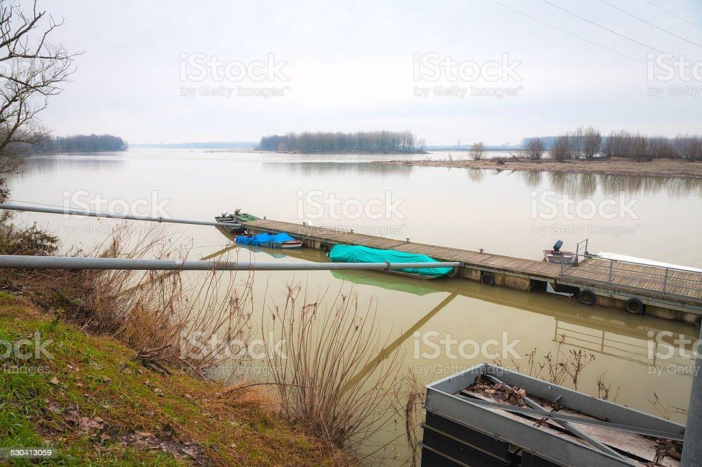 Po river, boats moorage in wintertime. Color image. stock photo