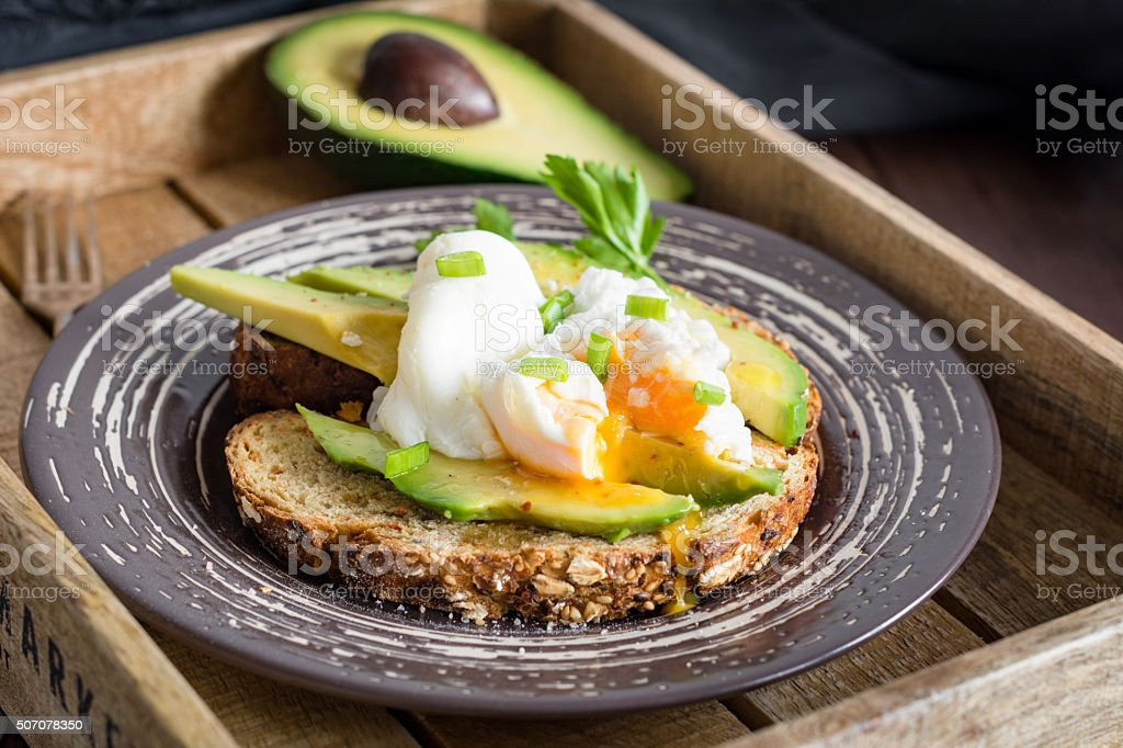 Poached egg and avocado toast stock photo