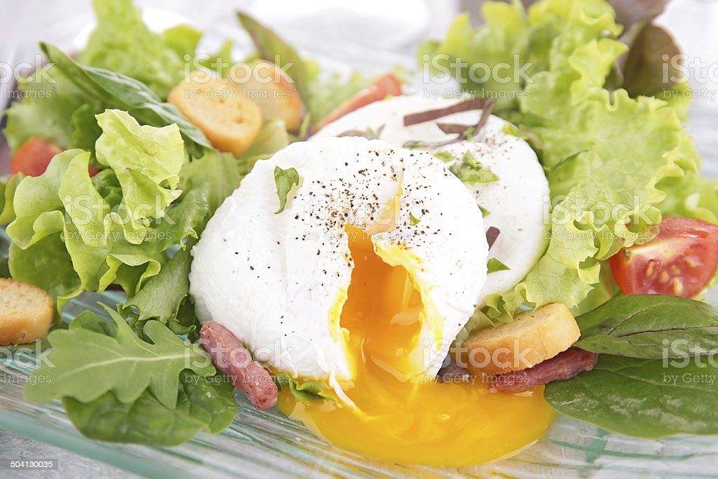 poached egg and salad stock photo