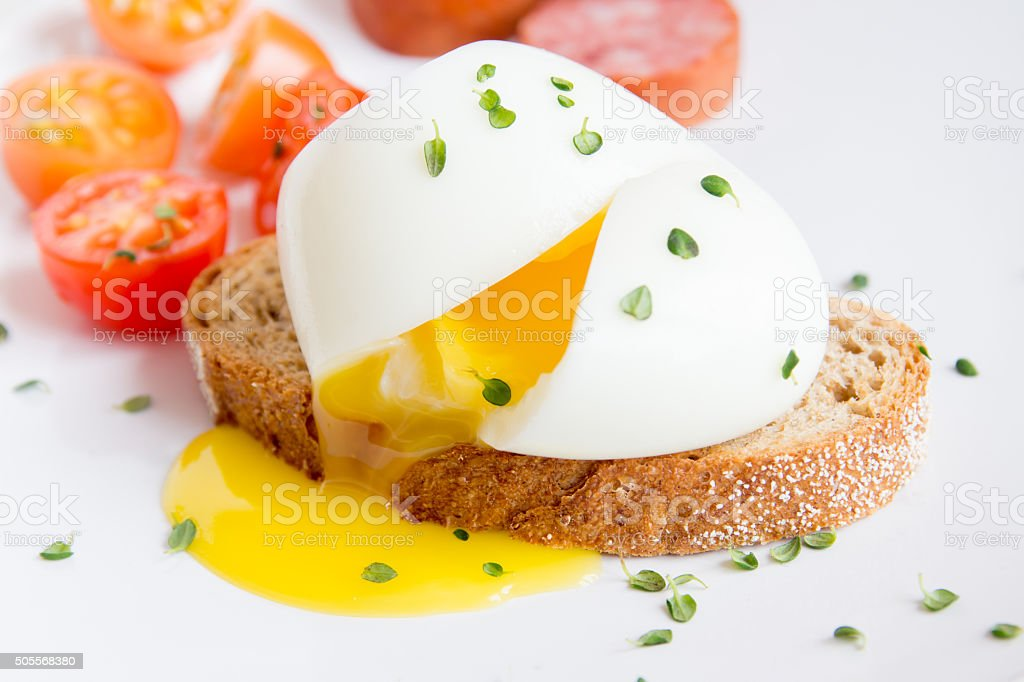 Poached egg on bread stock photo