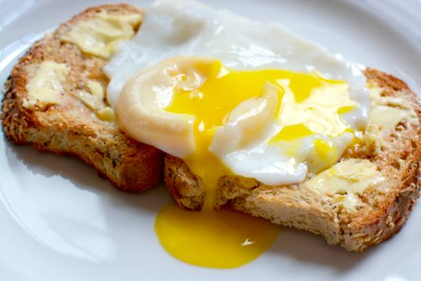 poached egg on toast - fried egg stock photos and pictures