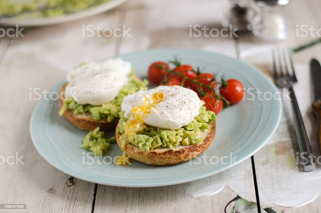 Poached eggs and avocado on toast stock photo