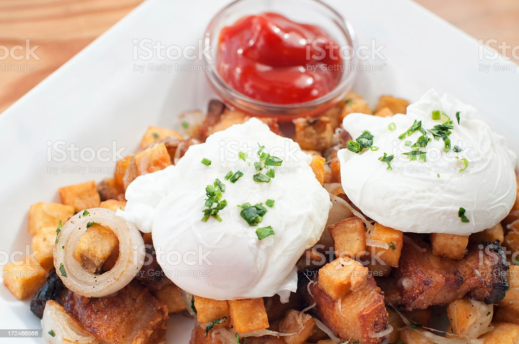 Poached Eggs and Pork Belly Hash royalty-free stock photo
