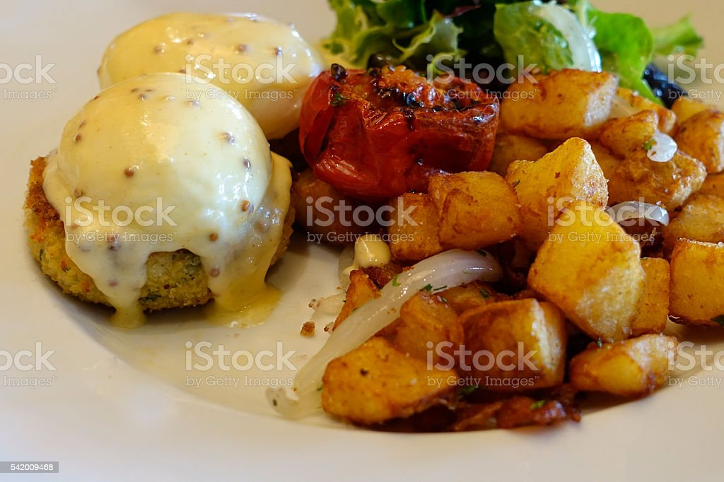 Poached eggs on crab cakes stock photo