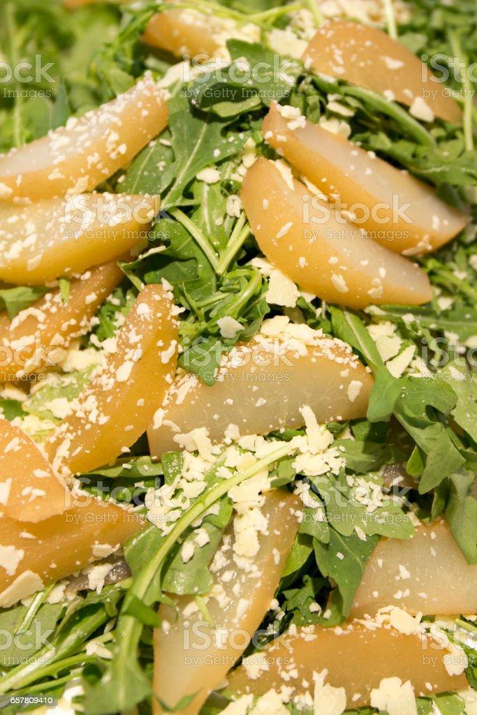 Poached Pear Rocket & Parmesan stock photo