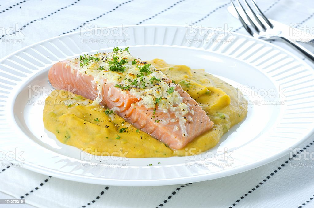 poached salmon fillet on mashed potatoes with fennel stock photo