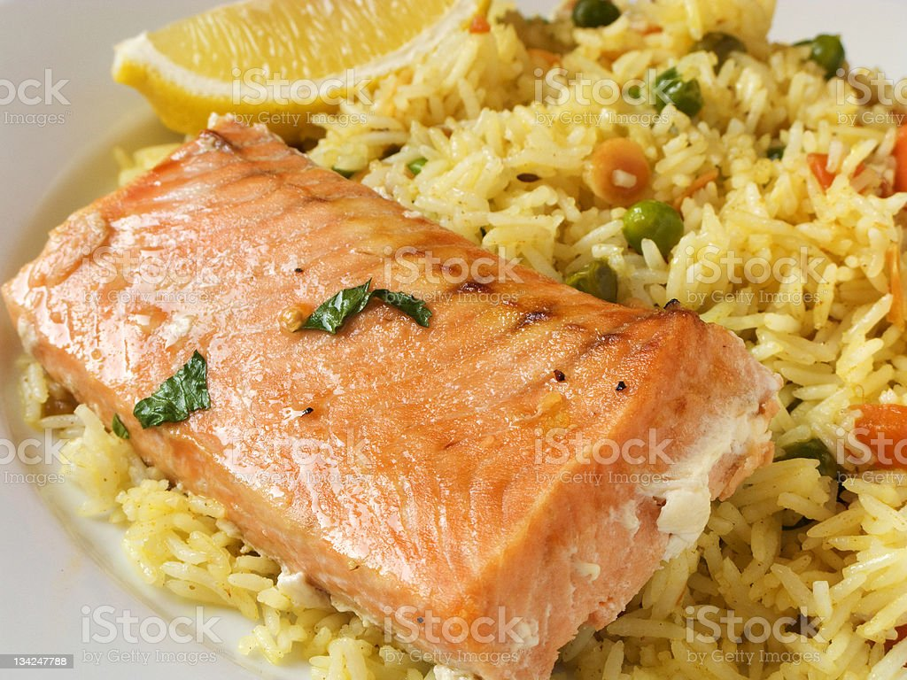 Poached salmon with saffron rice and mixed vegetables royalty-free stock photo