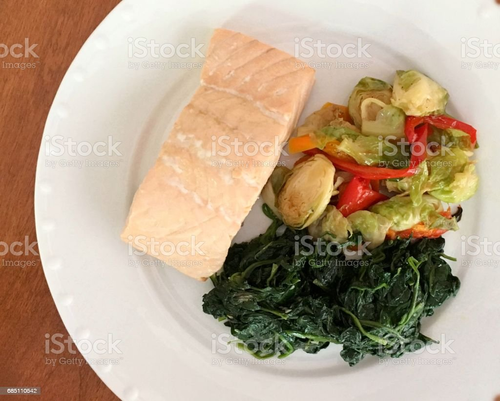 Poached Salmon with spinach and brussel sprouts royalty-free stock photo
