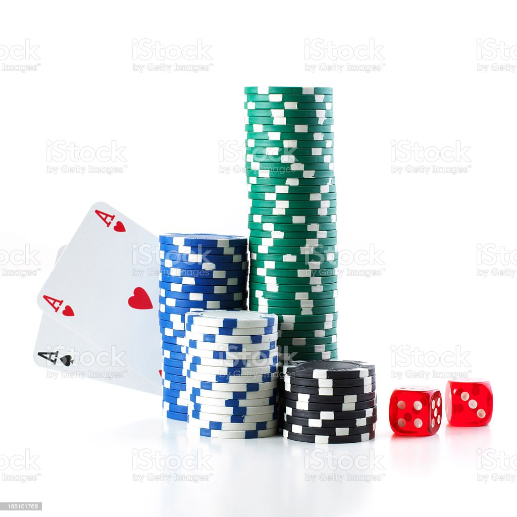 Pocket aces poker hand hiding behind a stack of poker chips stock photo