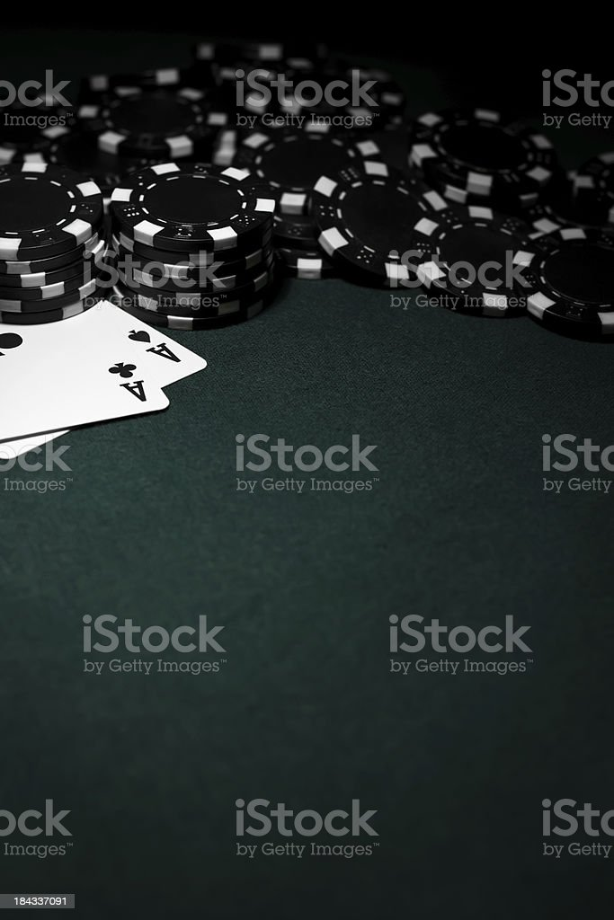 Pocket Aces with Black Poker Chips stock photo