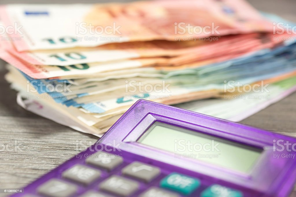 Pocket calculator and money stock photo