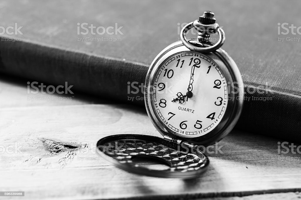 Pocket clock on books background Lizenzfreies stock-foto