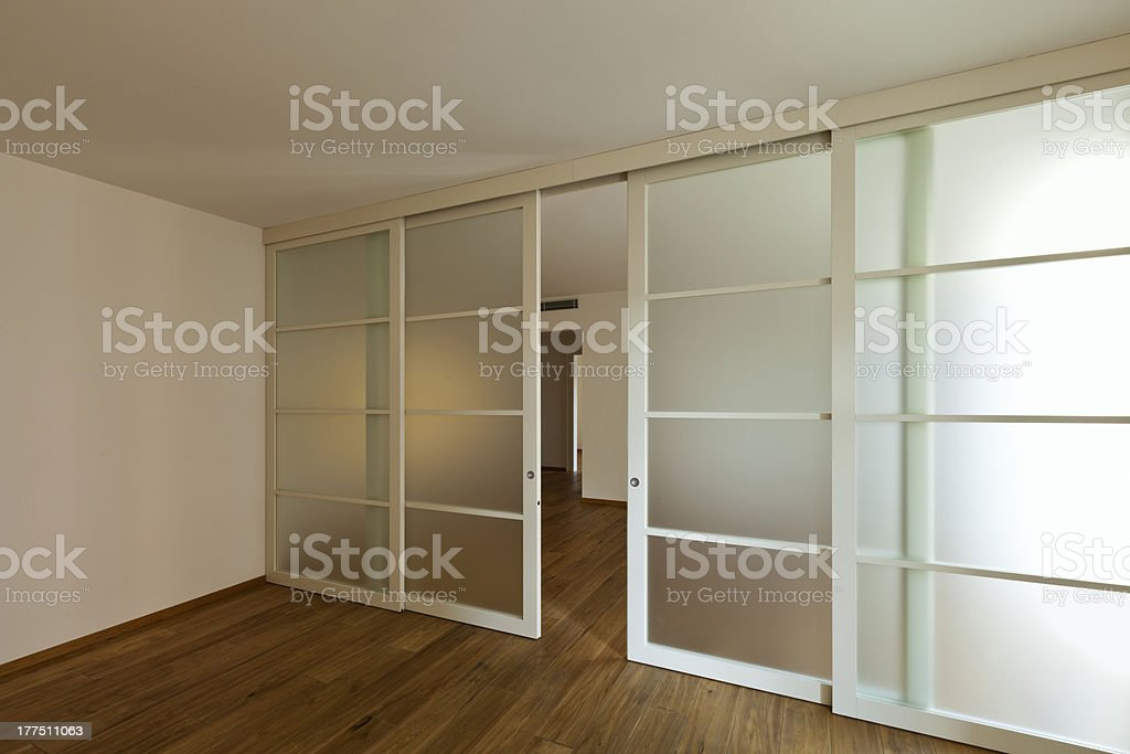Superb Pocket Doors Inside Of An Empty Home Royalty Free Stock Photo