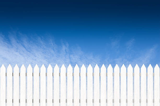 pocket fence painted white with blue sky - fence stockfoto's en -beelden
