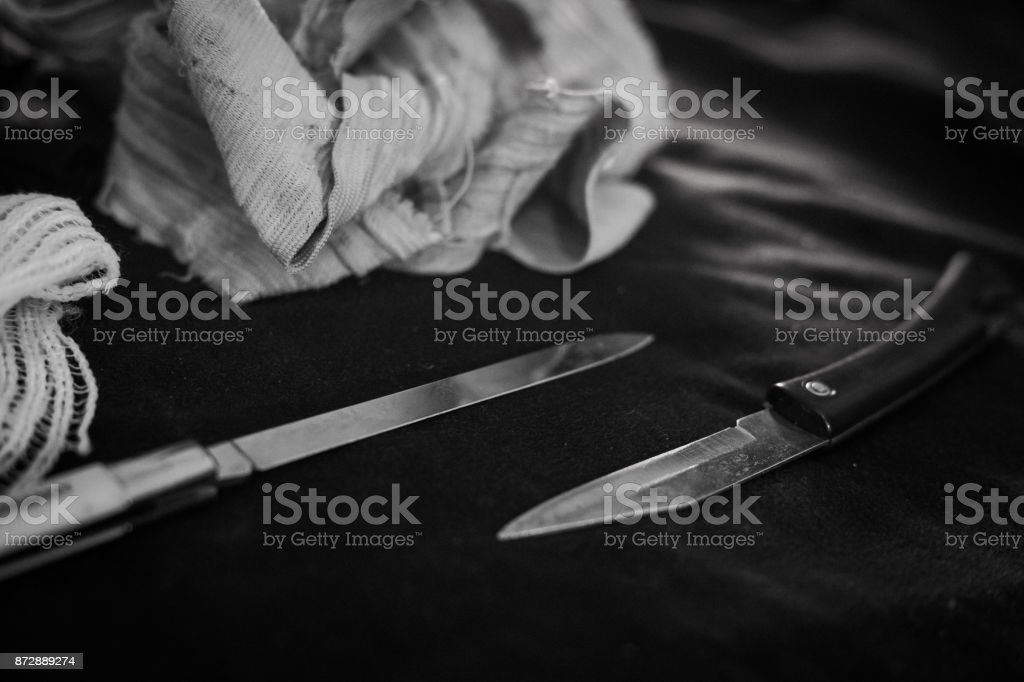 pocket knife in dark style stock photo