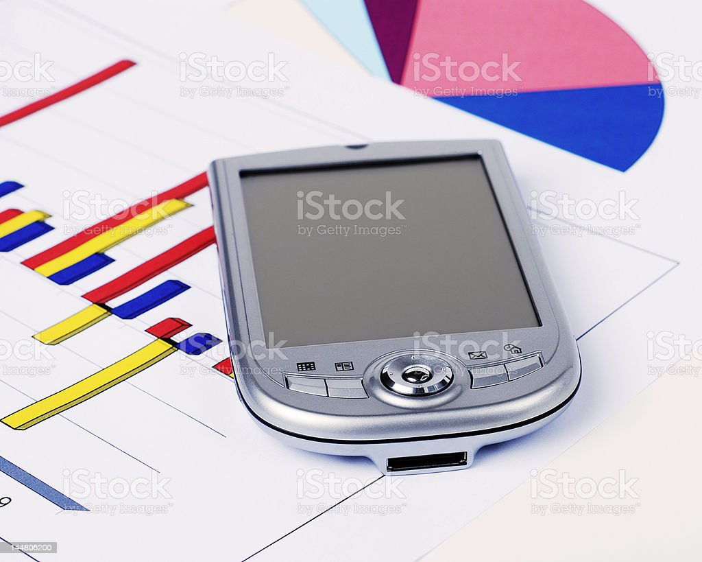 Pocket PC and Graphs royalty-free stock photo
