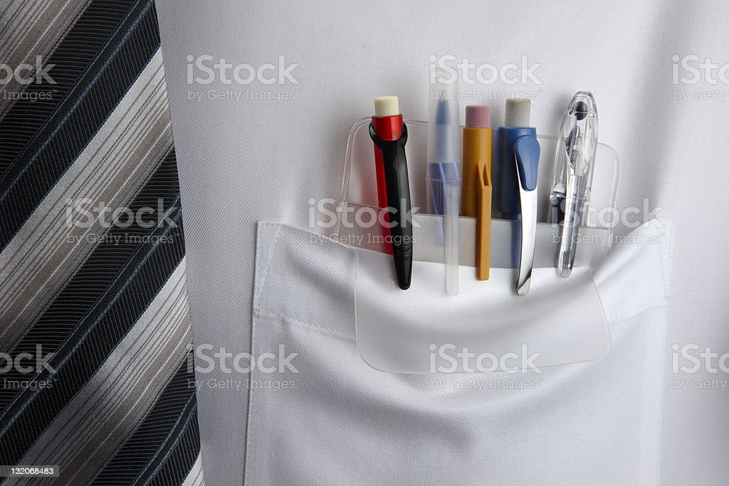 Pocket Protector Plastic pocket protector holding pens and pencils in white shirt Business Stock Photo