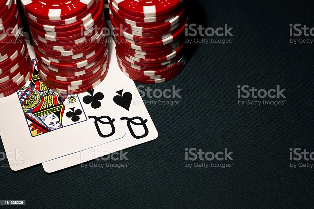 Pocket Queens with red poker chips royalty-free stock photo