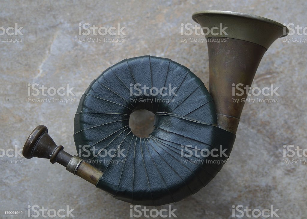Pocket sized hunting horn stock photo