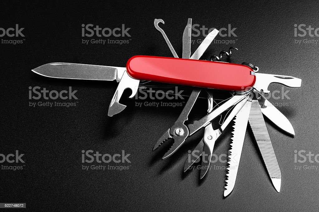 Pocket Swiss knife fully opened stock photo