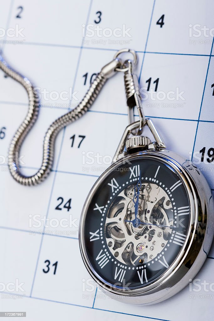Pocket watch and calendar royalty-free stock photo