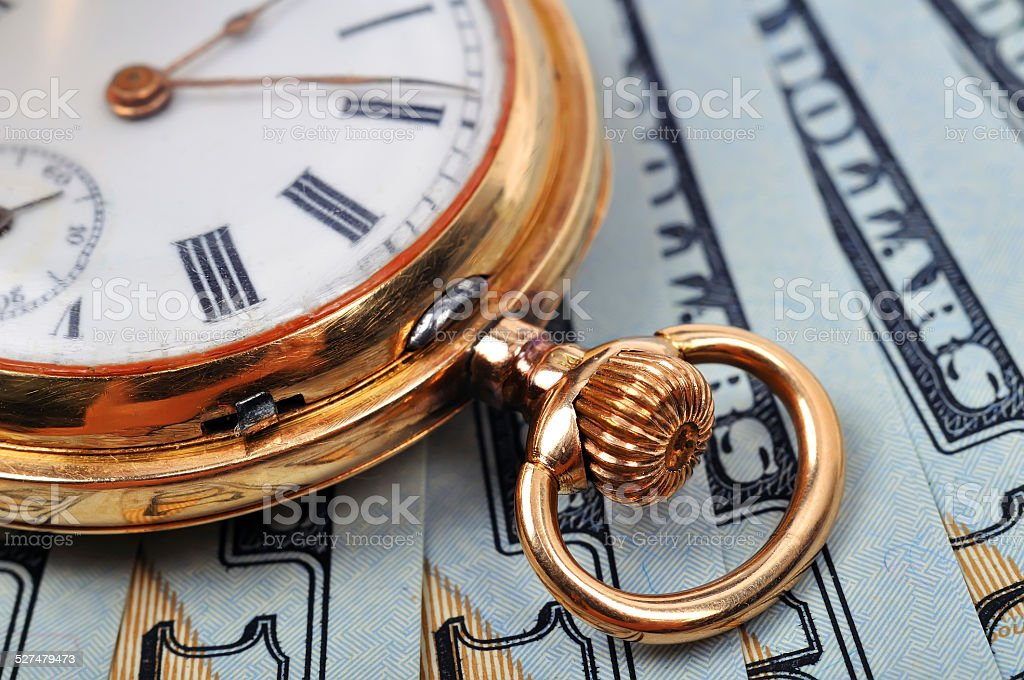pocket watch and dollars stock photo