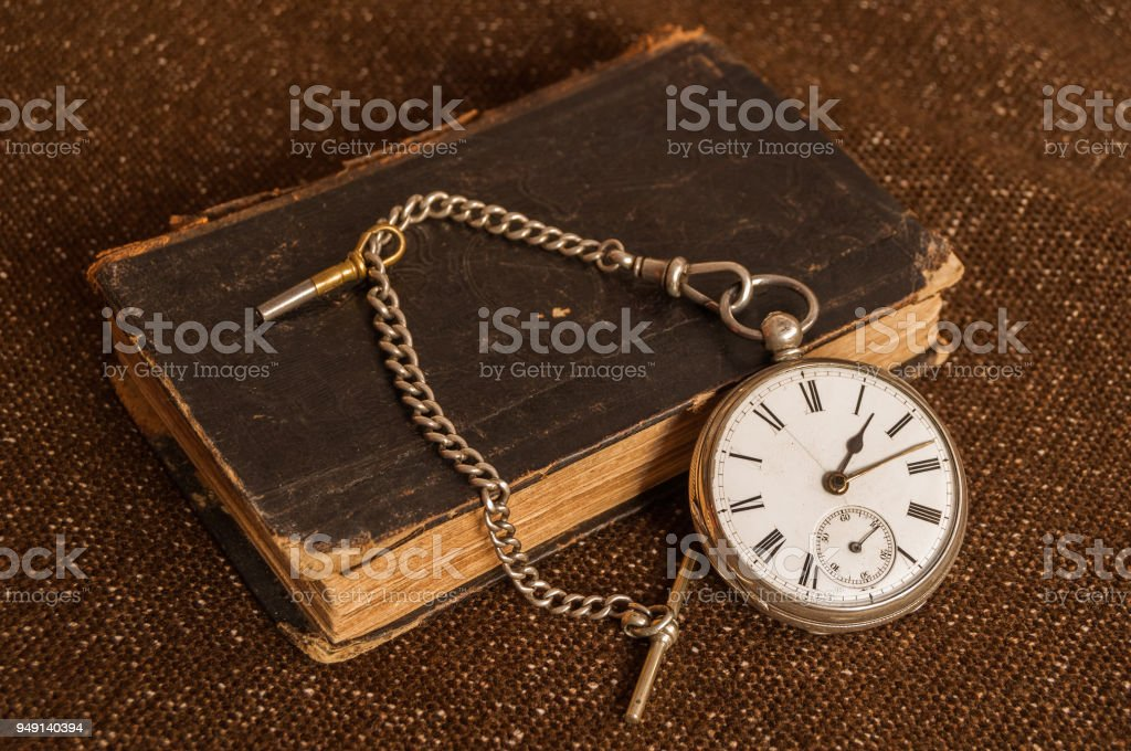 Pocket watch and old Bible stock photo