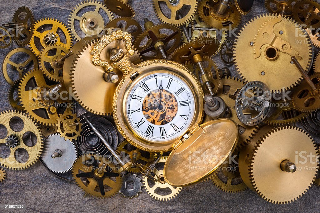 Pocket Watch and old Clock Parts - Cogs, gears, wheels stock photo